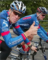 Lance Armstrong Riding His Bike with Floyd Landis